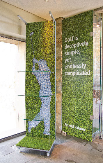 A tailored golf themed window display for Dunes course